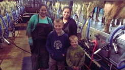 Milking time with employees and grandkids